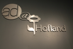 Brushed aluminium 3D letters raised from the wall Hofland