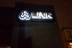 LED illuminated from behind titanium brushed gold letters on black metal box for LINK