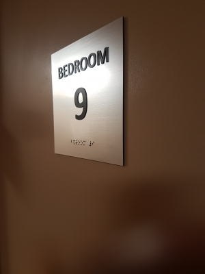 room numbers sign with raised text and braille
