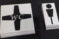 Brushed aluminium washroom signs