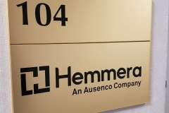 Brushed gold directional sign Hemmera