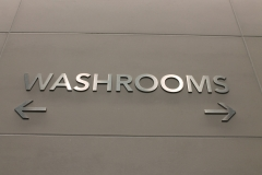Stainless steel raised washroom signs