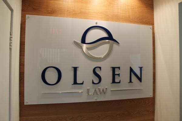 Lobby sign with aluminium raised logo Olsen