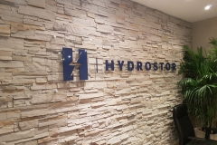 Clear acrylic reception sign with 3D raised logo Hydrostor