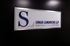 Singh Lamarche LLP custom 3D letters painted aluminium with double aluminium backer, installed with standoff pins.