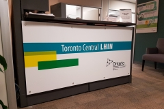 White acrylic reception sign installed with aluminium pins LIHN