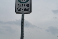 Reflective shared pathway sign
