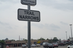 Reflective trail narrows and yeld signs
