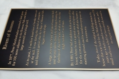 Bronze plaque with raised text